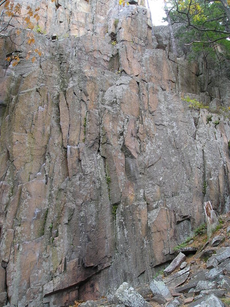 "Cliff drifts upwards with unbolted rock face.Good 5.10 route potential past the ""camp fire"" stained rock."
