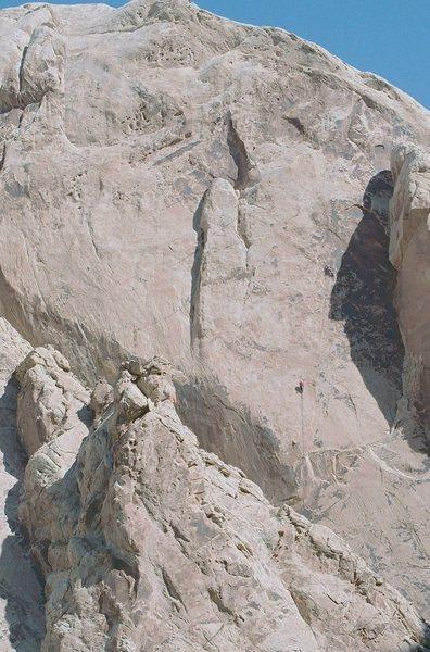 Rock Climbing Photo: Ground shot P2,Lance approaching the traverse left...