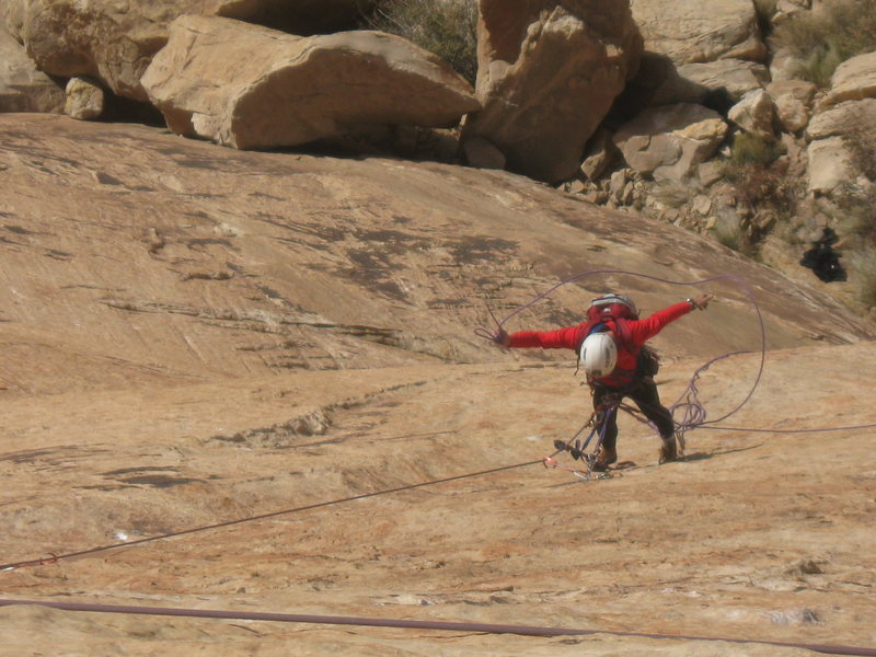 Paul doing strange rope manipulations on the hanging belay of P2 !. Photo Lance Bateman