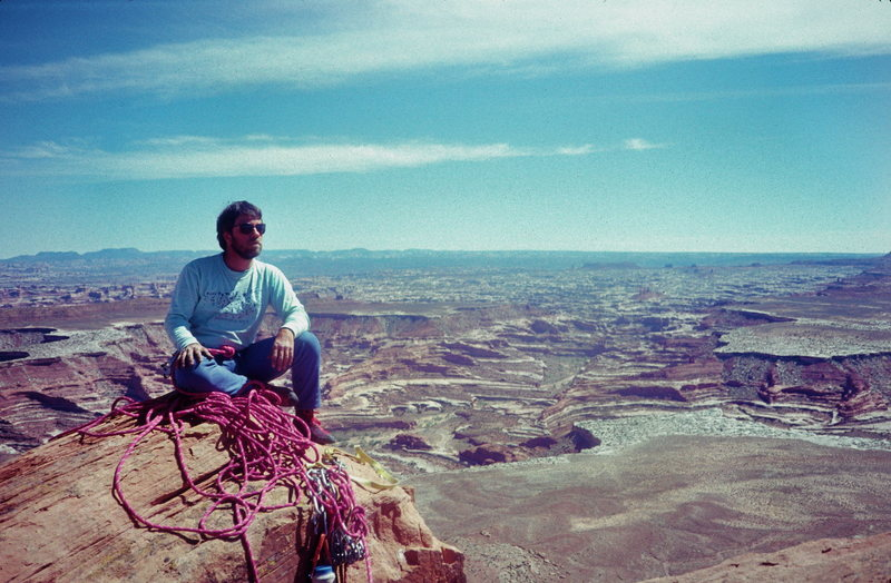 John Rosholt on the southern tip of Ekker Butte with the Maze in the background. May 1990