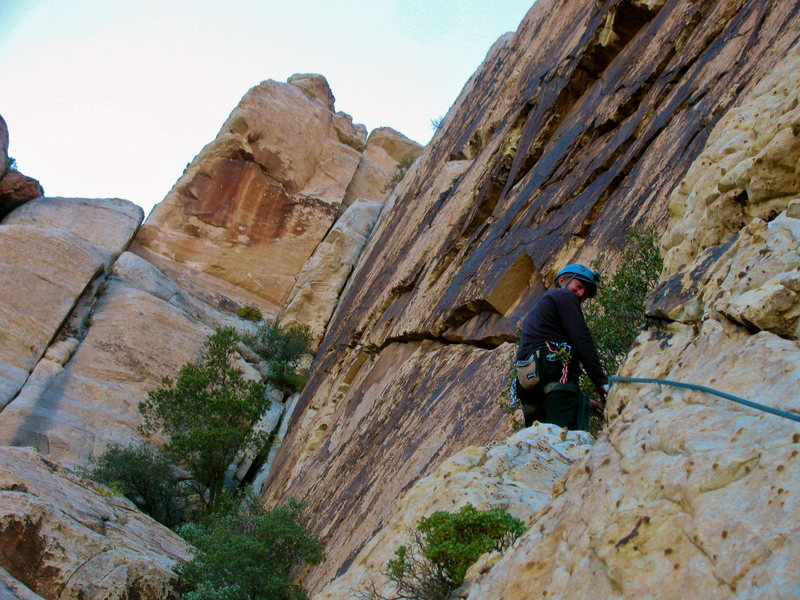 Ryan Belaying from the the bush on top of pitch 2.