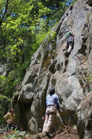 The last push to the ledge on the FA.  Glen on belay and Ryan in background.