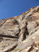 Rock Climbing Photo: P3 traverses the slab to the offwidth in the left-...