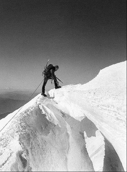 Errett Allen crossing a snow bridge on Mt. St. Helens, 1974. The bridge collapsed just after I crossed it.