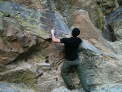 Rock Climbing Photo: Eric getting set for the big reach to the final cr...