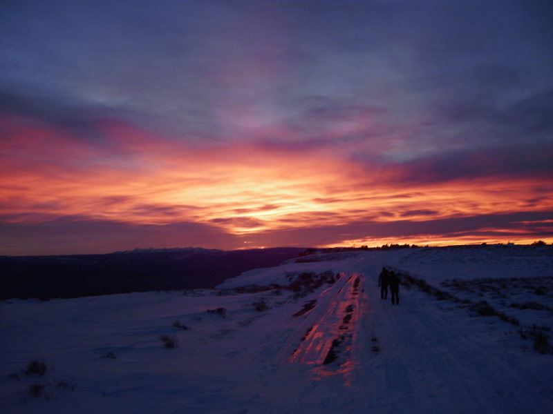 Starting the 3.5 mile hike back to the vehicles right at sunset. Hikers, Lynda Christensen and Jason Adams.