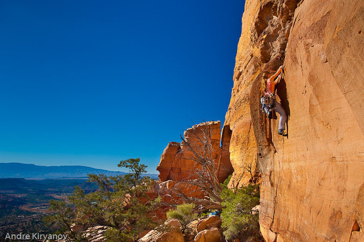 Leah Sandvoss on the first pitch (5.10) of Swinging Monkey Phenomenon, Upper Beach, Church Spires, Sedona, AZ<br> Photo by Andre Kiryanov
