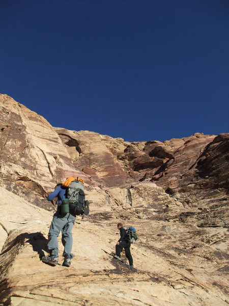 Climbers from Golden CO on the approach to Eagle Wall. They were headed for Levitation 29.