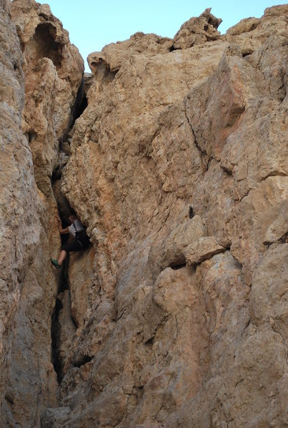 Reni pulling out the pro I placed at the chockstone. The chockstone is just above her.