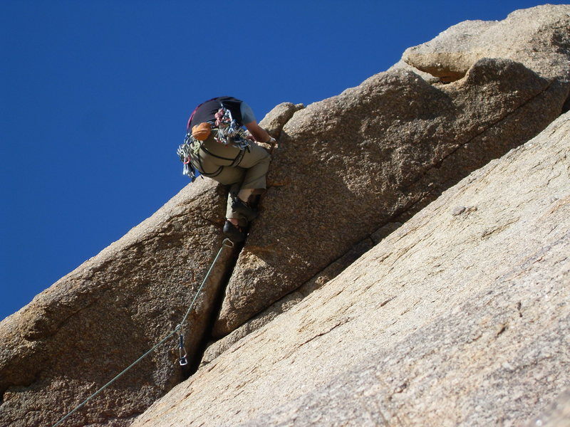 Moving into the lieback crux move.