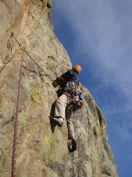 Dave is about to make a long reach right, perhaps the crux of P4.