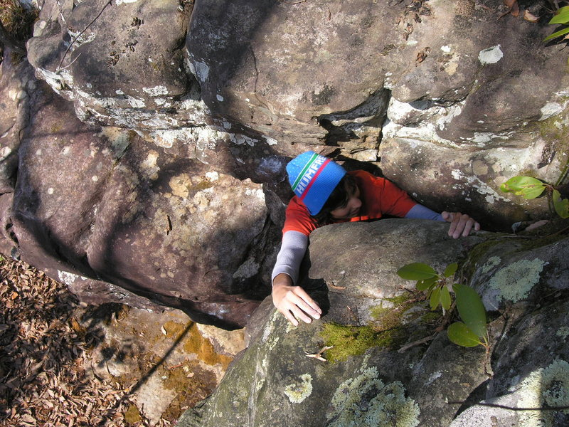 "Sheila Rahim squeezing through the top out of ""Juggernaut"" (V1)."