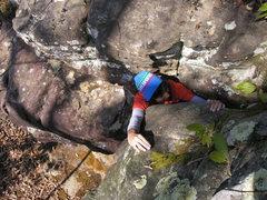 "Sheila Rahim squeezing through the top out of ""Juggernaut"" (V1)."