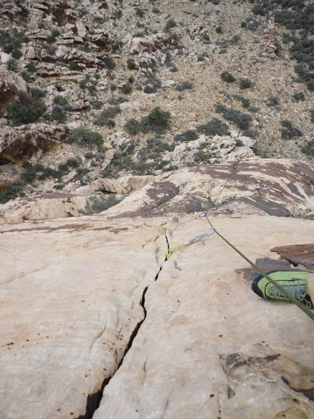 Looking down the crack in the slab of pitch 3.