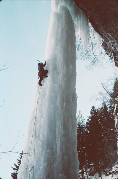 Climbing The Fang in 1996. Notice the top is unattached by about 3 feet. It was near the end of the season and time to finish climbing on it.