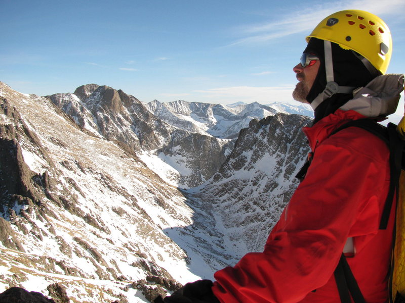 Paul Crowder enjoying a calm clear February day on the top of Crestone Needle.