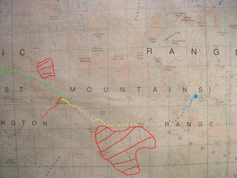 Mount Waddington Route Map<br> contour interval: 40 meters<br> grid:  one kilometer squares<br> <br> Red - Wiessner-House Rt<br> Yellow squares - Bravo Gl Rt<br> Green - Fury Gap-Angel Gl Rt<br> Red zones - Avalanche!<br> Blue Square - Plummer Hut<br> Tiny blue dots - Many near misses