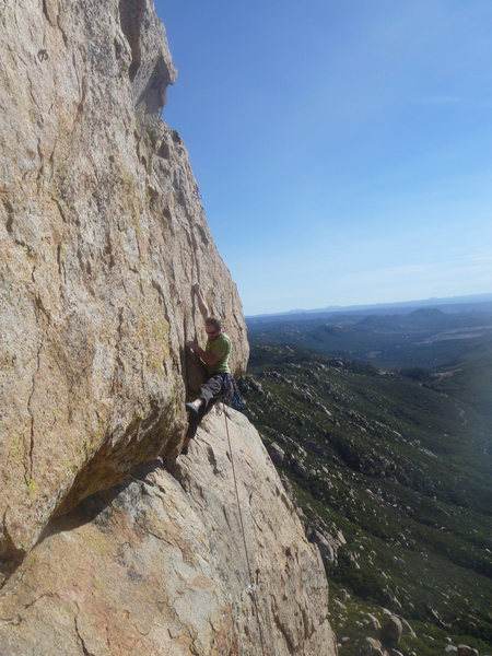 Rock Climbing Photo: The crux move... finding good feet can be tricky