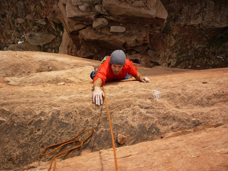 Jake Warren following the Disappearing Devil.  Great face climbing between the horizontal breaks!