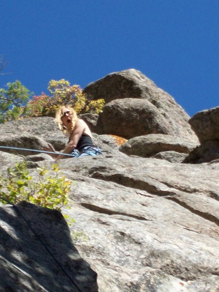 Mrs. Jana yelling at me for putting her on another new pile. New route Mine Hole Crag.
