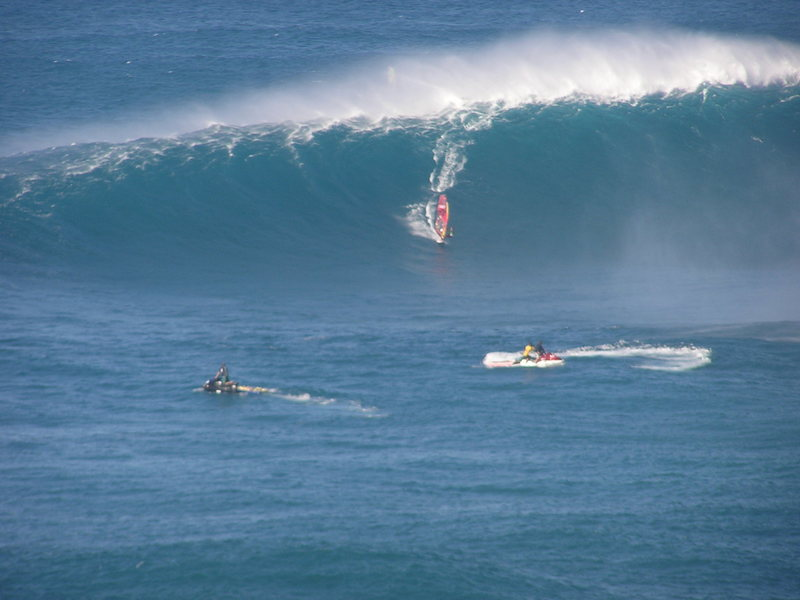 """Kai Lenny dropping in at """"Jaws"""" on his windsurfer.Photo: Olaf Mitchell"""