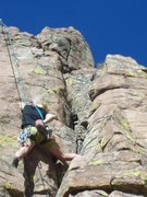 Ian and Pat route just off ledge stepping off flake and heading up clean slab past closely placed bolts and fun crux.