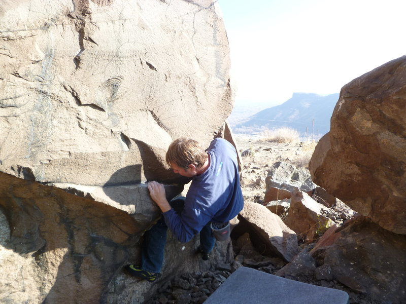 Rock Climbing Photo: Pulling on the starting hold with the left hand.