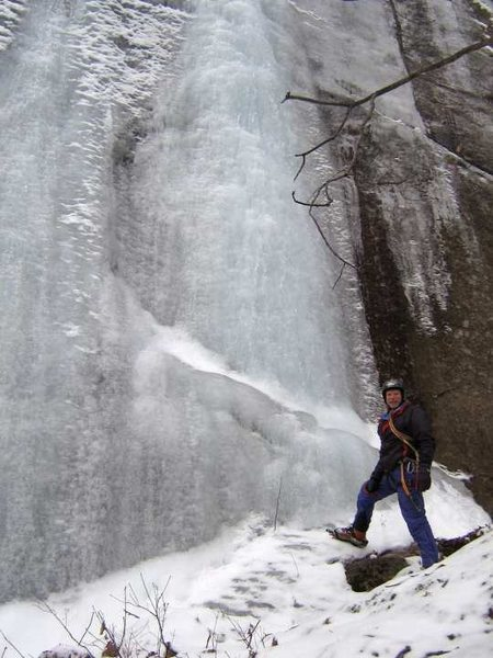 Tom Lane at the base of Fifi's Frozen Fingers. This route lies along a sloping bench about 200 yards south of  and below the 2 uppermost pitches of the Waterfall Wall.