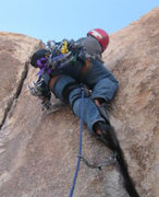 Rock Climbing Photo: Leading Right Sawdust Crack (5.8) in J-Tree. Solid...