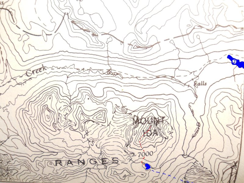 Mount Ida South Ridge<br> From Putnam & Kruszyna, 1985<br> Rocky Mtns of Canada North<br> AAJ & CAJ 1st edition 1921<br> <br> Red dashes - South Ridge<br> Blue - Lakes<br> J - western Jarvis Lake<br> Blue dashes - Bernadette Rt?<br> <br> Most of what we want to see is off this map to the east.  Peakfinder can help spot the roads and glacier travel.
