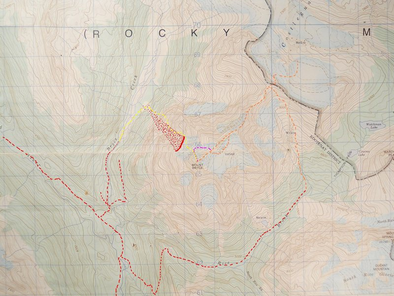 MOUNT BRYCE, NORTH FACE<br> contour interval: 100 feet<br> one kilometer grid<br> <br> red dashes - logging roads<br> red dots - serac hazard<br> orange - NE Ridge<br> yellow - original NFace<br> violet - NF via NE Ridge<br> <br> All approaches are approximations.