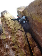 Rock Climbing Photo: The crux of the first pitch.  Facing outward seems...