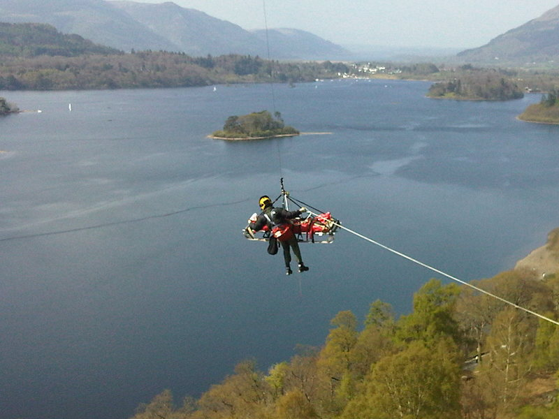 Lake Derwentwater just outside the town of Keswick and a Heli Rescue from Falcon Crag of a climber who may not be appreciating the view . Photo Ian Carr