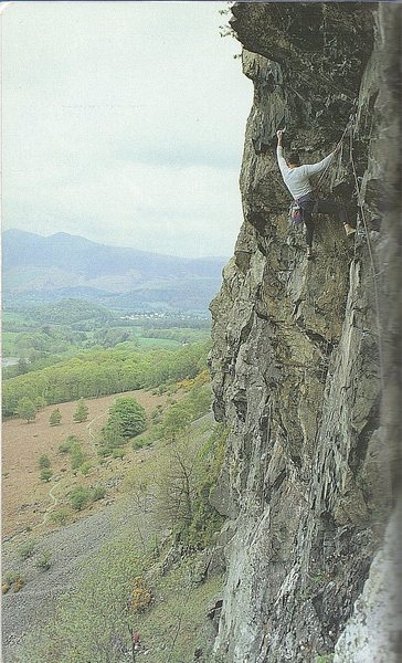 Climber on the difficult second pitch.The town of Keswick just visible in the background.  Photo Dave Kells