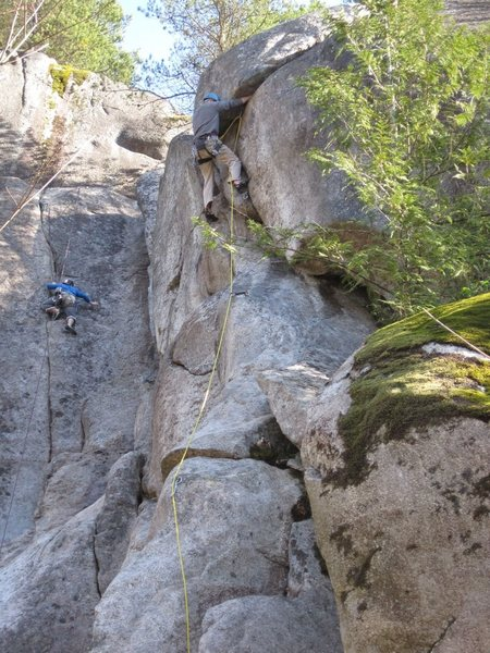 Jay Burbee on the FA of Sex (in the foreground). A steep final crux, moving right at the capstone. Seam of Destiny is in the background.
