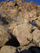 Rock Climbing Photo: Jacob on the talus scramble with the climbs in the...