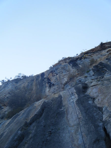 Upper overhanging section on classic limestone pockets and fins.