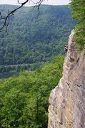 Katherine Marek cleaning Party in my Mind on a beautiful day in the New River Gorge.  Photo taken by Chris Murray.