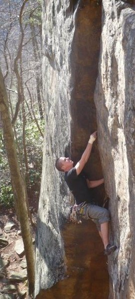 Rock Climbing Photo: Chad Williams placing a piece on Autumn Fire.