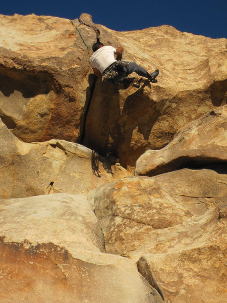 Tony Bubb follows Joseffa Meir past the crack and onto the jugs and heal-hooks of Roller Ball (5.10) in the Outback of J-tree.  Photo by Erin Haas, 11/2010.