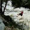 Crossing the river via the Tyrolean traverse. Boulder Creek was huge that day.<br>
