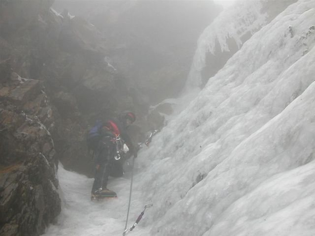 (Mar 2005) At the crux, in a vertical dihedral