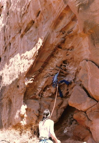 Project - Breaking the Law (5.10?) - Day 1<br> <br> Scotty working his way up the pockets, January 1986.  Billy F with the belay.