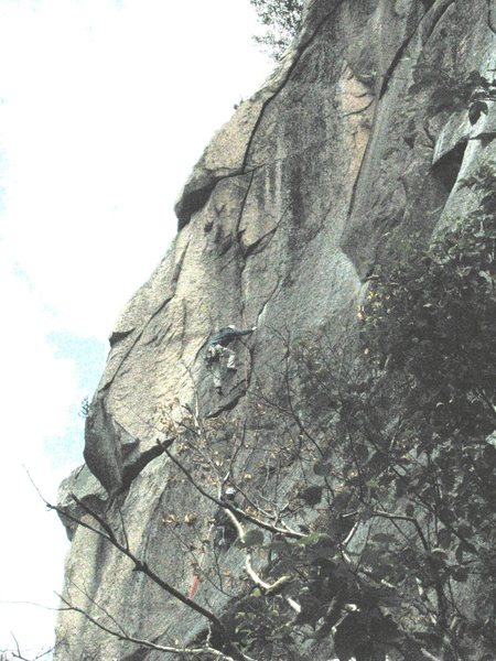 Pat McElaney heading up to exhaust himself in the third pitch overhanging off-hands crux of Crack of the World. The position of the route can be better seen here:http://www.mountainproject.com/v/new_hampshire/owls_cliff/the_left_cliff/106925995 in the background, above the climber.