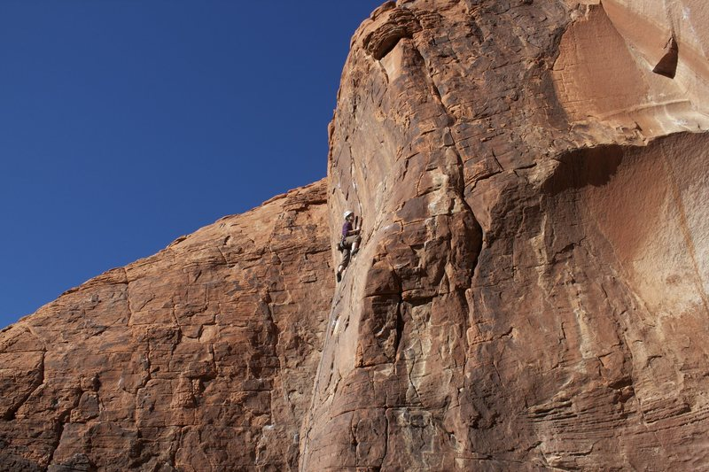 Kate nearing the crux finish of When the Cat's Away