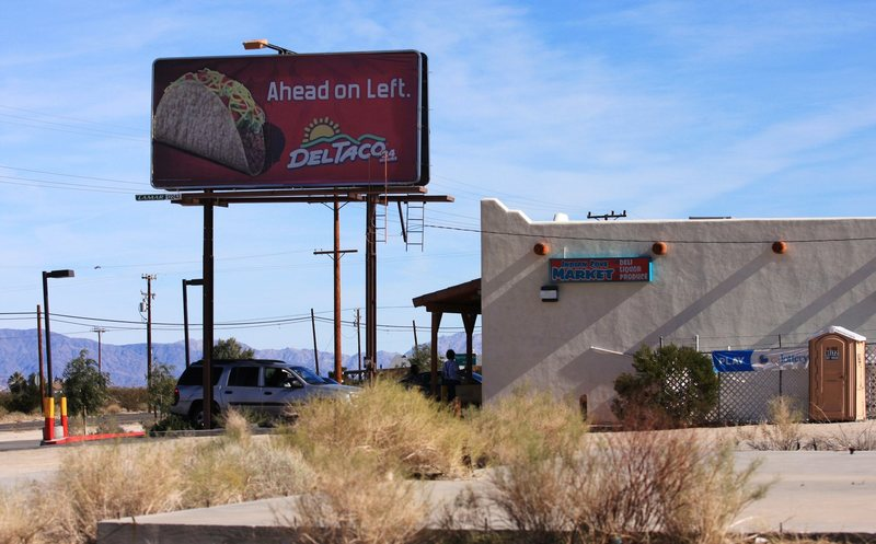 Del Taco sign, and general store.