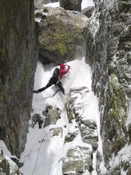 Kevin Landolt tackling a killer snow mushroom on the fourth pitch of The Petit Gully.  Photo by Chris Sheridan, taken 1/15/11.