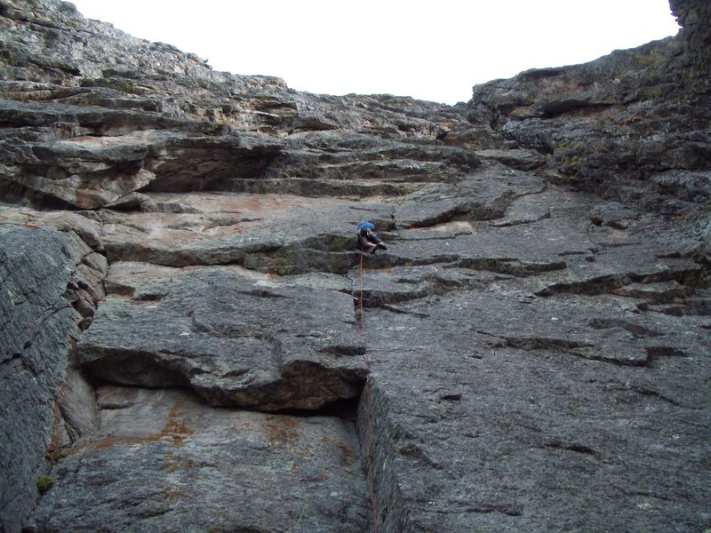 Trad climbing up the mid-section of Merlin's.