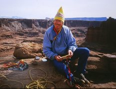 Bill Ellwood on top of Standing Rock, 1987.  The aluminum box to the left of Bill is the original summit register, permanently affixed with a Star Dryvin bolt, apparently by the first ascent team.  Their signatures were still there.