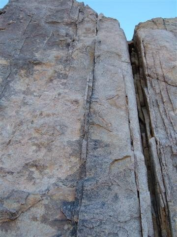 The route climbs the incipient crack just to the left of the wide crack.